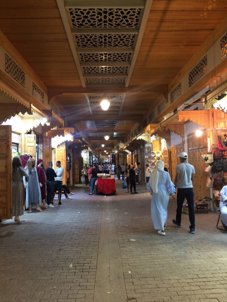 Part of Rabat's Medina which has wooden storefronts and roof.
